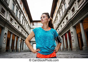 Fitness young sporty woman in front of Uffizi gallery,...