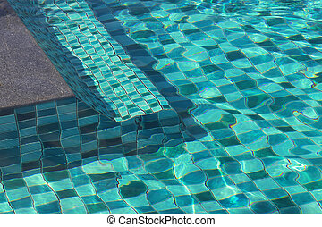 Swimming pool with transparent water