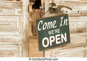 Come In Were Open on the wooden door open Vintage retro...