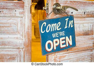 Come In We're Open on the wooden door open. - Come In We're...
