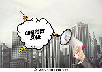 Comfort zone text on speech bubble and businessman hand...