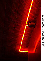 Red neon glow - The corner of a red neon border, reflecting...