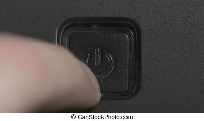 Male finger pressing a power button - Male index finger...