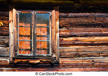 Cottage house window - Closed wooden log window in an old...