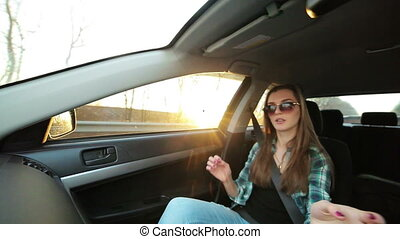 Beautiful girl dancing in the car