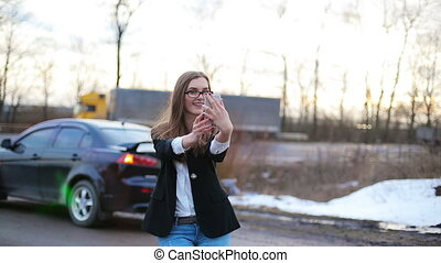 Young beautiful woman photographing themselves on the phone....