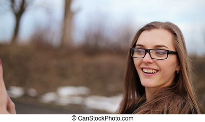 Beautiful girl in glasses photographed