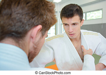 Two young men in martial art combat