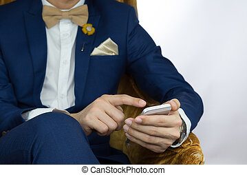 man in blue suit using mobile phone - Man in blue suit with...