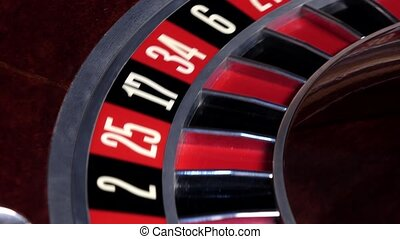 Roulette wheel running and stops with white ball on zero -...