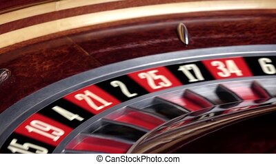 Roulette wheel running and stops with white ball on 33 -...