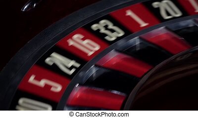 Usual roulette wheel running with fallen white ball, close...