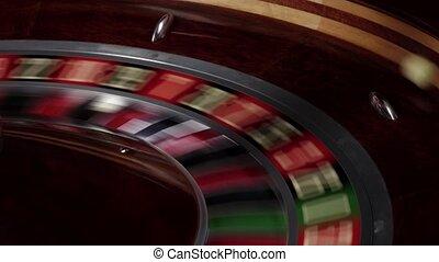 Roulette wheel fast running, white ball falls - Roulette...