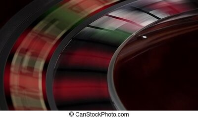 Fast running wheel of roulette, white ball falls, close up -...