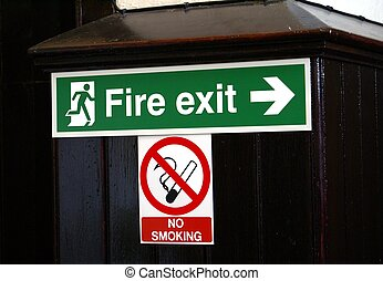 Fire exit sign. No smoking sign