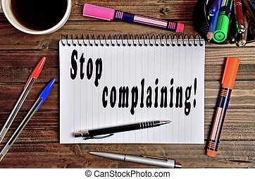 Stop complaining - Stop complaining written on notebook