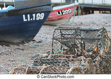 wooden fishing boat on a pebble beach - Fishing boat on...