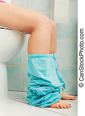 woman sitting on toilet in morning - Woman with constipation...