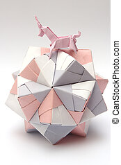 Origami unicorn riding paper ball - Pink origami unicorn...