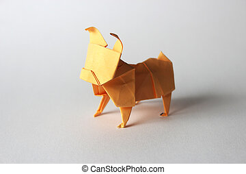 Origami pug - Orange paper origami pug isolated on white...