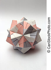 Colorful modular origami ball isolated on white