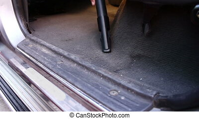 Cleaning A Car With A Vacuum Cleane - Close up Cleaning A...