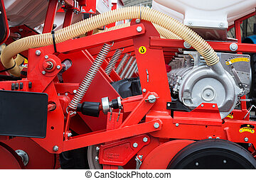 Red modern agriculture machine used for seeding