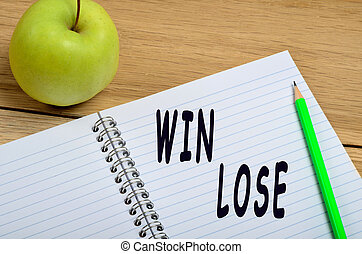 Win Lose words on notebook
