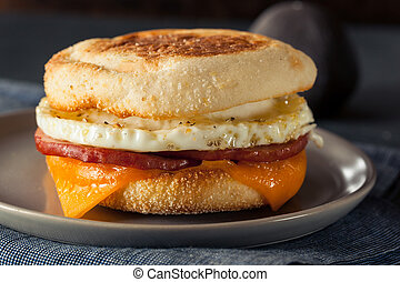 Homemade Breakfast Egg Sandwich with Cheese on an English...