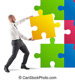Complete a puzzle - Businessman complete a puzzle inserting...