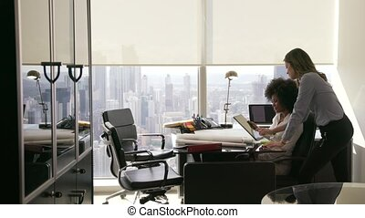 1 Female Colleagues Architect Using Tablet PC In Office -...