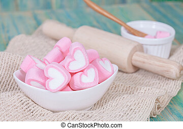 Colorful sweet marshmallow in a white-ware