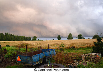 stormy clouds over field