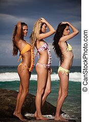 Attractive Young Women Wearing Bikinis