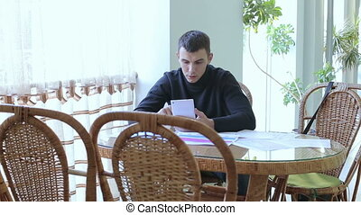 The guy and girl working in cafe