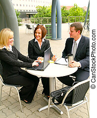 Business Team Discussing - three business people working...