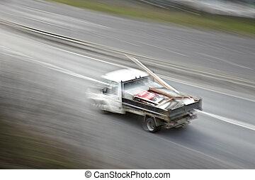 Work Van - White work van speeding along the motorway