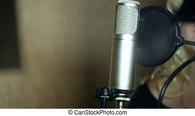 the girl singing in the Studio - Studio microphone and pop...