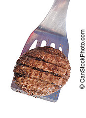Grilled Hamburger Patty on a Spatula Isolated on White