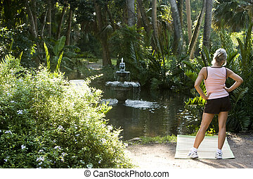 Mature woman on exercise mat enjoying nature