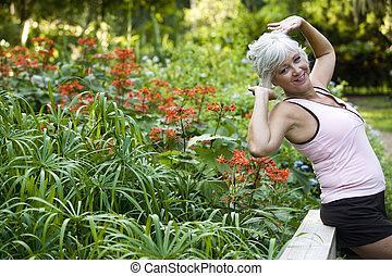 Mature woman enjoying fresh air and park foliage