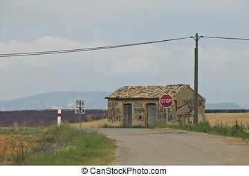 Graffiti-Covered Building in a Rural Landscape