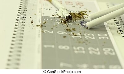 A concept of stop smoking; cigarettes on a calendar.