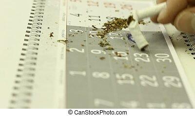 A concept of stop smoking; cigarettes on a calendar