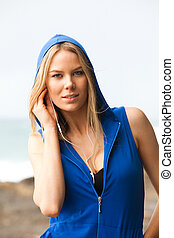 Young Woman With Sleeveless Hoodie at the Beach - Portrait...
