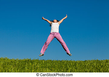 "young female jumps in field - ""Real""Woman jumping against..."