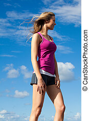 Young Woman Standing in the Wind