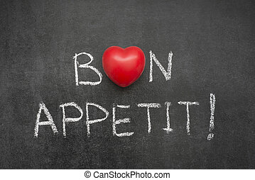 bon appetit exclamation handwritten on blackboard with heart...