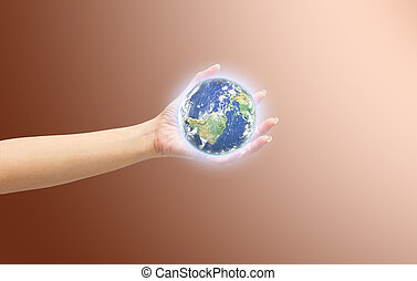 Human hand holding Earth planet. Elements of this image are...
