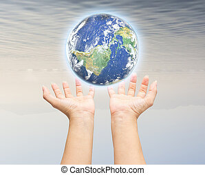 Human hand holding Earth planet Elements of this image are...